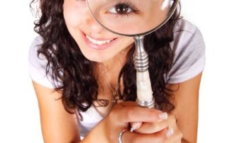 Woman with a magnifying glass looking for a job