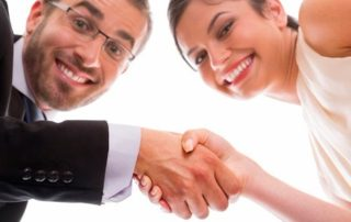 Happy people shaking hands after interviewing for a job