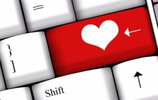 Keyboard with red heart on the Enter Key