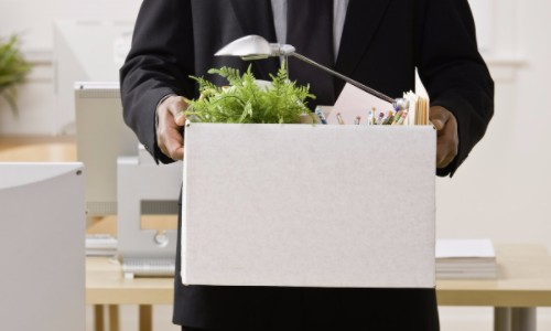 Fired Employee Leaving with Box of Personal Belongings