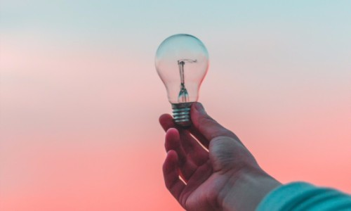 Entrepreneur with an Idea Aolding a Light Bulb