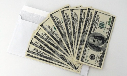 Money in an envelope used to pay salaries or bonuses